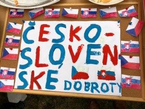 Czech flags on a handpainted sign announcing Czech-Slovak baked goods