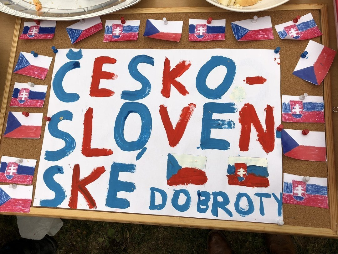 Czech flags on a handpainted sign announcing Czech-Slovak baked goods