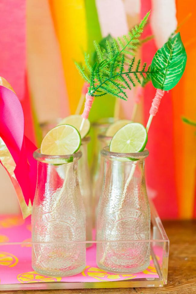 Vintage mini milk bottles with tropical stir sticks for a Tropical party: Luau, Hawaiian, and Moana theme. Small World gets big with cultural party themes | Halfpint Design