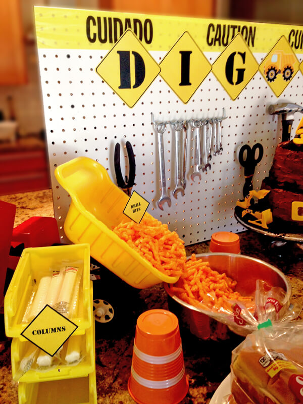 "Construction Party Menu | Halfpint Design - Cheetos from the dump truck is so classic! Love the barrel cups, and cheese stick ""columns"""