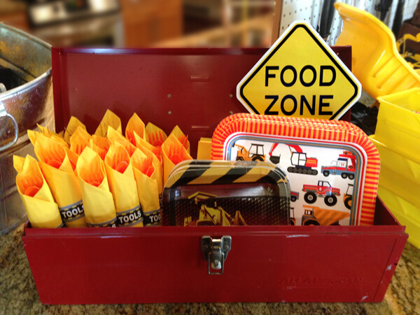 Construction Party Menu | Halfpint Party - food zone. Plates, napkins, and cutlery arranged in an old toolbox!