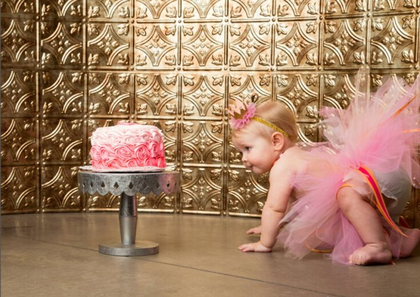 Planning Your First Children's Birthday Party | Halfpint Design - Darling baby girl with her first birthday smashcake