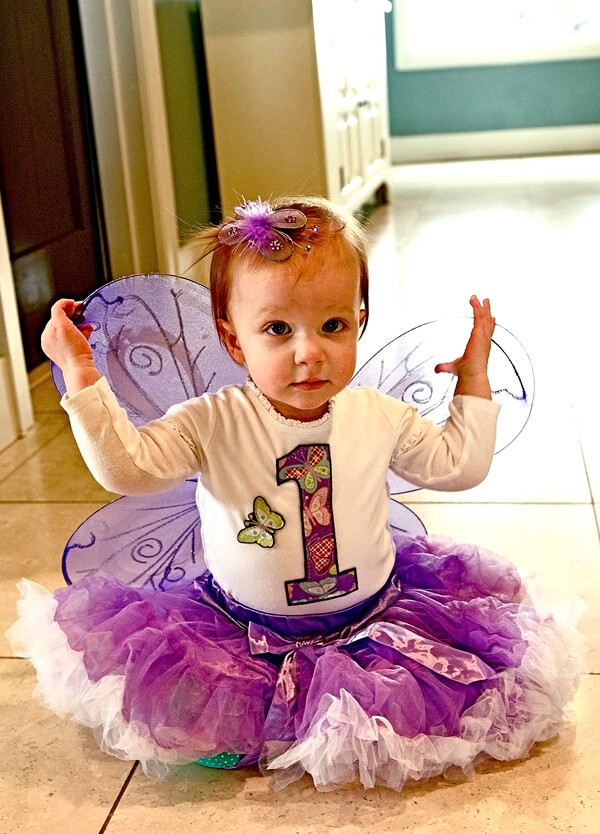 Butterfly First Birthday Party | Halfpint Design - Birthday girl wasn't too sure about her wings.