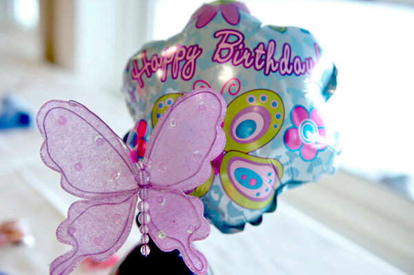 Butterfly First Birthday Party | Halfpint Design - Vases with large butterflies and dollar store mini-butterfly balloons dotted the sitting area