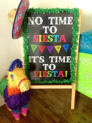 "Host a Fabulous Fiesta for Cinco de Mayo | Halfpint Design - ""No time to siesta, it's time to fiesta"" sign welcomes guests to the Cinco de Mayo party."