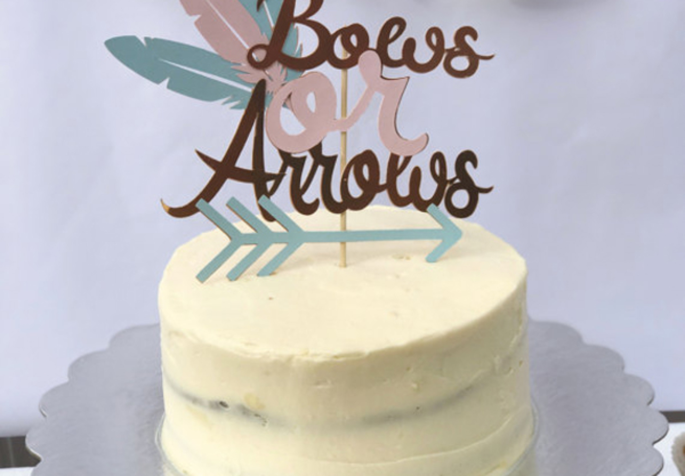 Bows and Arrows Gender Reveal Party Ideas | Halfpint Design - Bows or arrows cake topper is a nice addition to a gender reveal party.