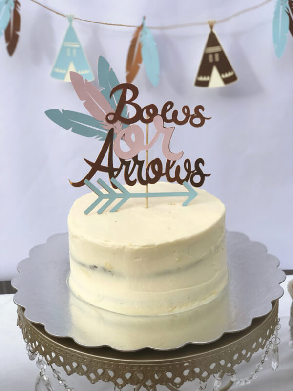 Humorous Gender Reveal Party Ideas | Halfpint Design - Bows or arrows cake topper is a nice addition to a gender reveal party.