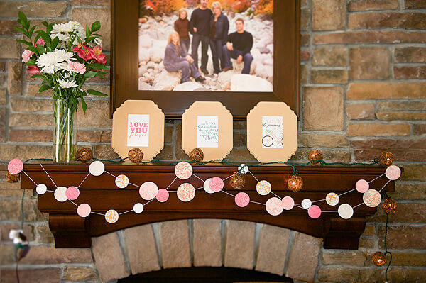 Vintage Coral & Gold Baby Shower | Halfpint Design - Mantel decor of dot garland, fresh flowers, and framed art featuring printable quotes and graphics perfect for the nursery.