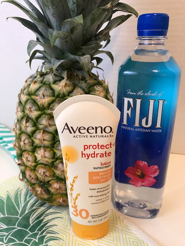 Tropical End of Year Teacher Gift Idea | Halfpint Design - A great tropical gift bag for the health conscious teacher. Great water, low chemical sunscreen and a pineapple. All we need now is a good book and a lounge chair on the beach!