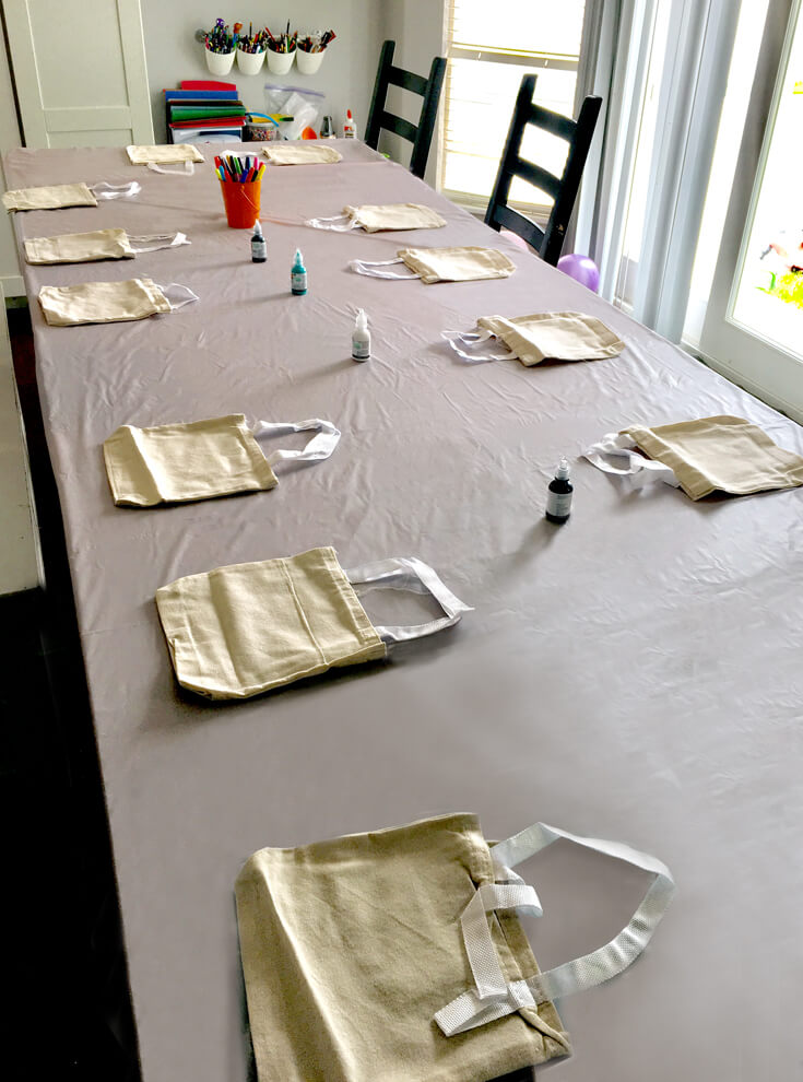 6th Birthday Book Party | Halfpint Design - Decorating book bags is a must for a book party. Set it all up before guests arrive for a smooth transition.