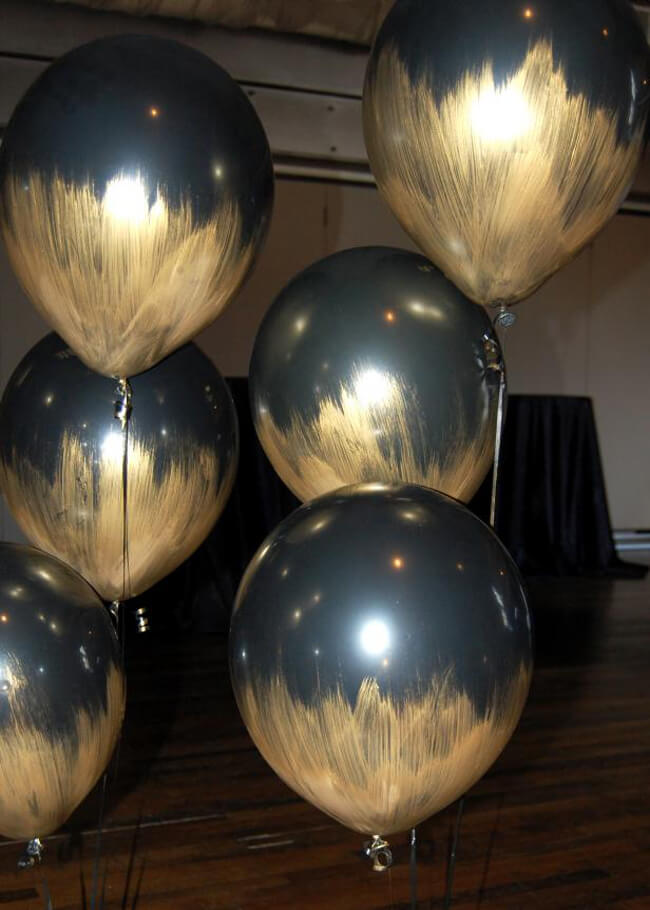 Holiday Decor Double Duty | Halfpint Design - These gold brushed black balloons are perfect for an Oscar party, Great Gatsby party, 50th anniversary, or masquerade. Black and gold is the perfect party color to use before and after New Years. Double Duty New Years decor.