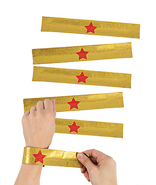 These slap bracelets are great Wonder Woman accessories and make perfect favors. Classy Wonder Woman Birthday Party Decor | Halfpint Design
