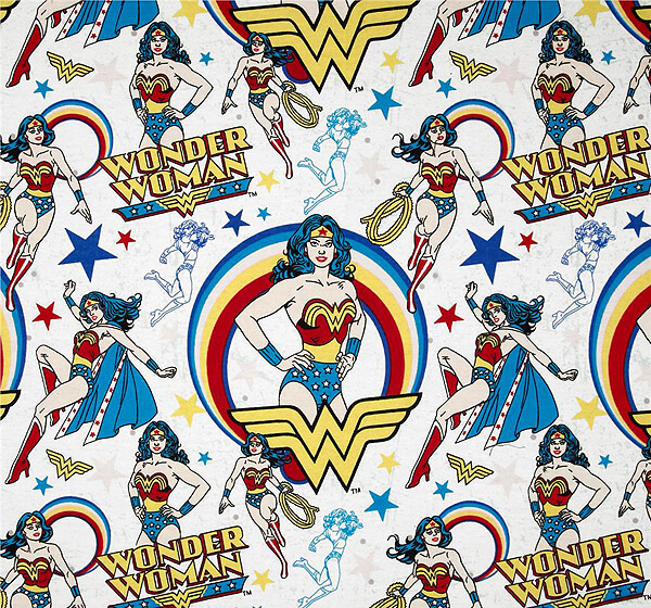 Use comic Wonder Woman fabric for an affordable backdrop. Comic Wonder Woman Party | Halfpint Design, party ideas, party themes