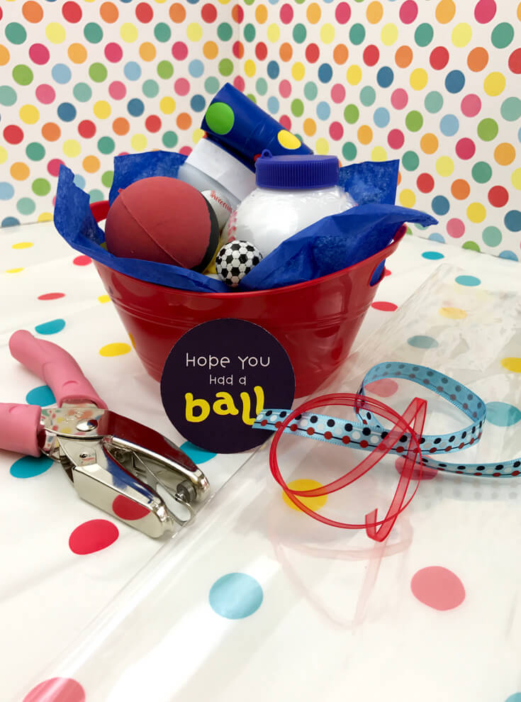 Ball Party Favor DIY | Halfpint Design - This easy party favor is so simple. Just pile in your stuff making sure all items can be seen.