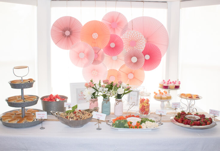 Gorgeous handmade rosette backdrop. Good thing she's got a talented mother-in-law! The rosettes created a lovely backdrop for the food table. - Sweet Little Peach Baby Shower | Halfpint Design