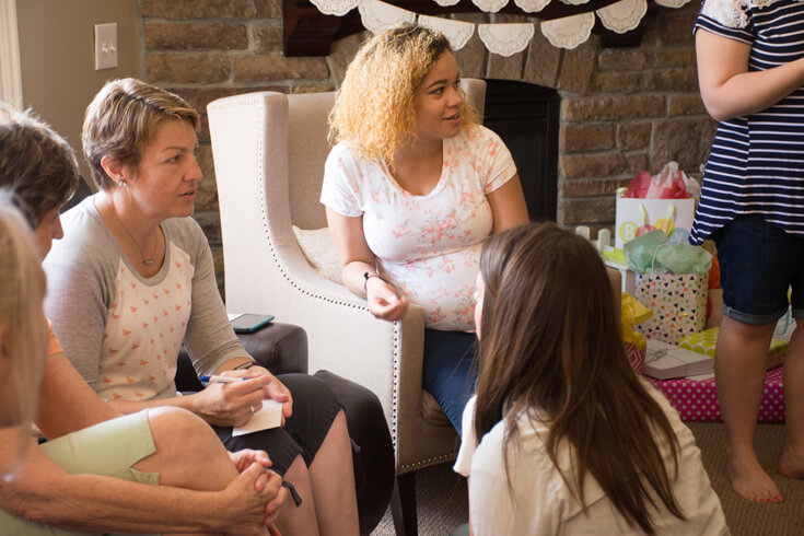 Mommy-to-be enjoying Baby Shower Jeopardy with her guests - Sweet Little Peach Baby Shower | Halfpint Design