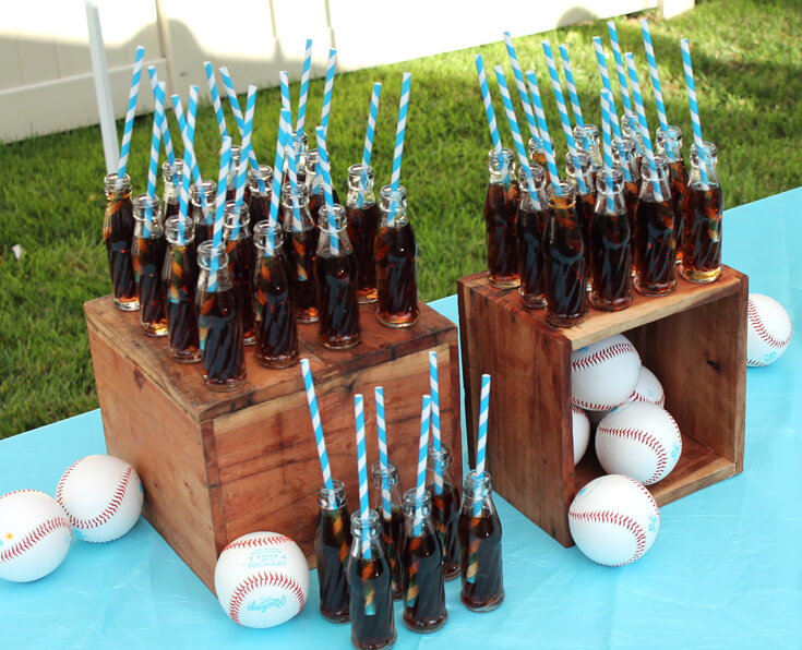You can't have a baseball game without a Coke! These mini coke bottles are so darling especially displayed on wooden crates. Yankees Baseball Themed Baby Shower | Halfpint Design - boy baby shower theme, baseball party