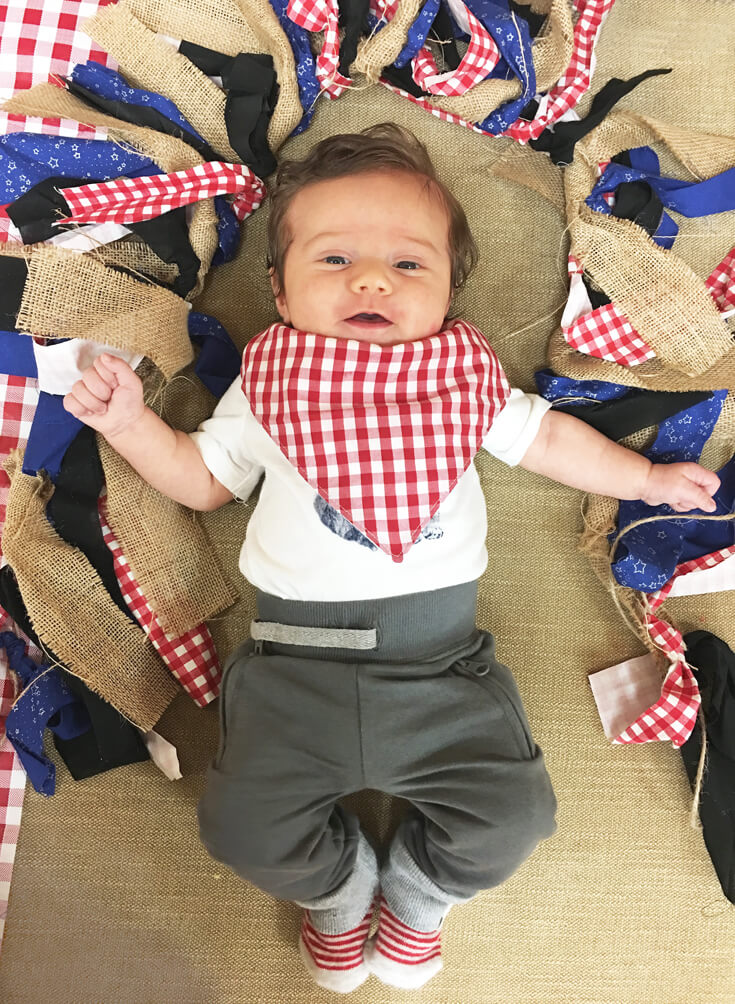 The cutest little guest sporting his checked bandana bib! Seriously the best bibs. Find out where you can get this baby for a Red, white, and BBQ party | Halfpint Design - summer party, Memorial weekend bbq, 4th of July, Labor Day party, BBQ party, Oktoberfest, neighborhood grill, brat party