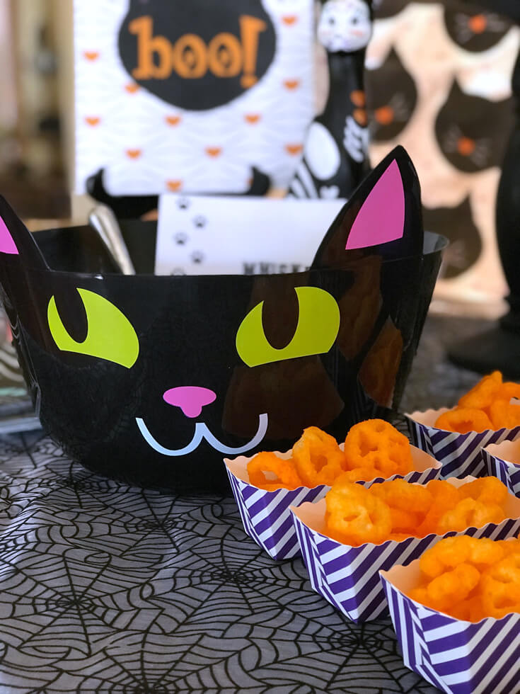 """Check out the dollar store when you start planning. This bowl was the perfect find! """"Black Cat Halloween Party Reveal"""" on Halfpint Design - Halloween party ideas, kitty cat party, kids party, cat party treats"""