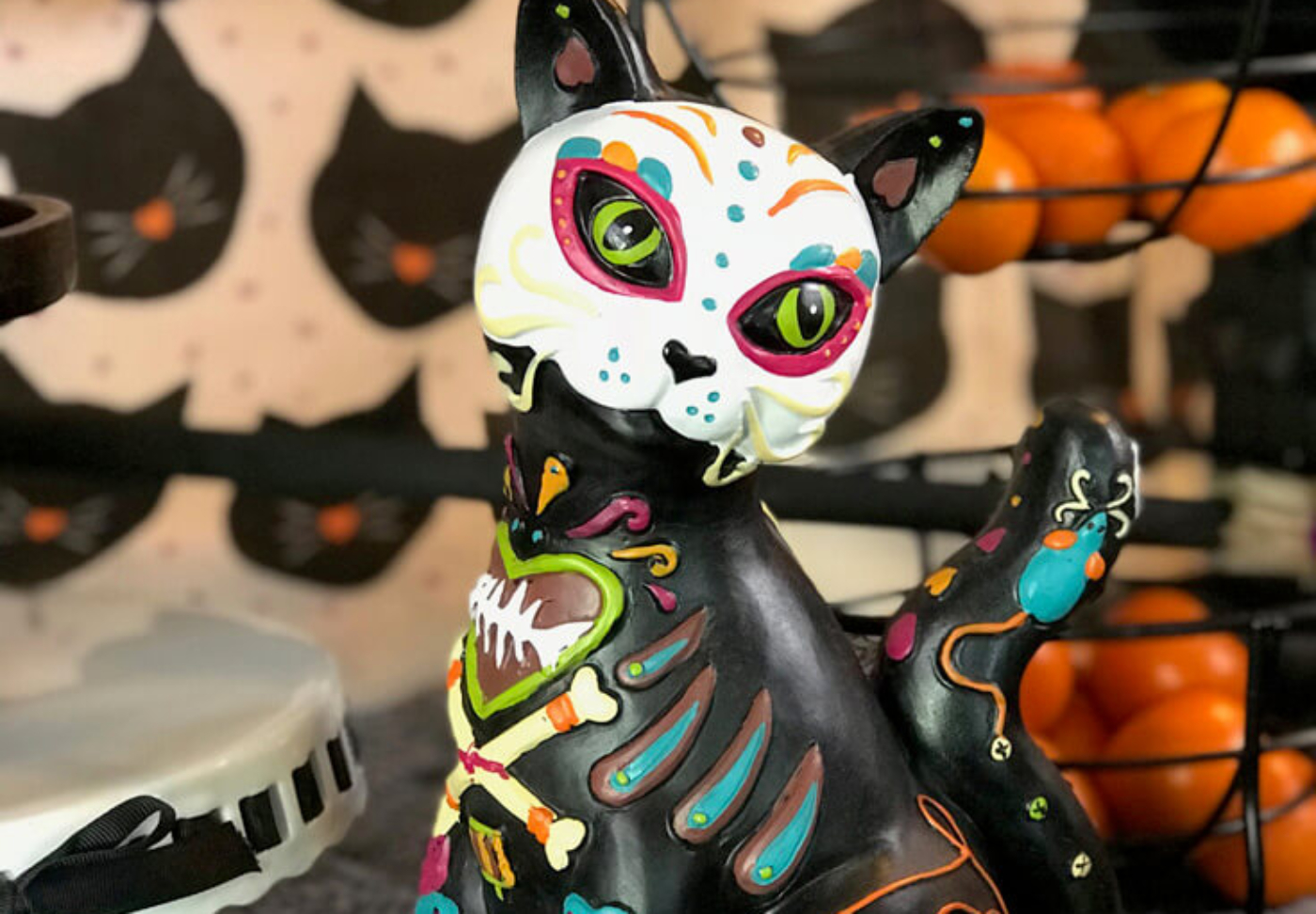 I love this Day of the Dead cat! How cute is she!? It's bigger than I thought and so pretty. Dia de los Muertos Party Resources | Halfpint Design - Halloween party, party decorations, party clothes