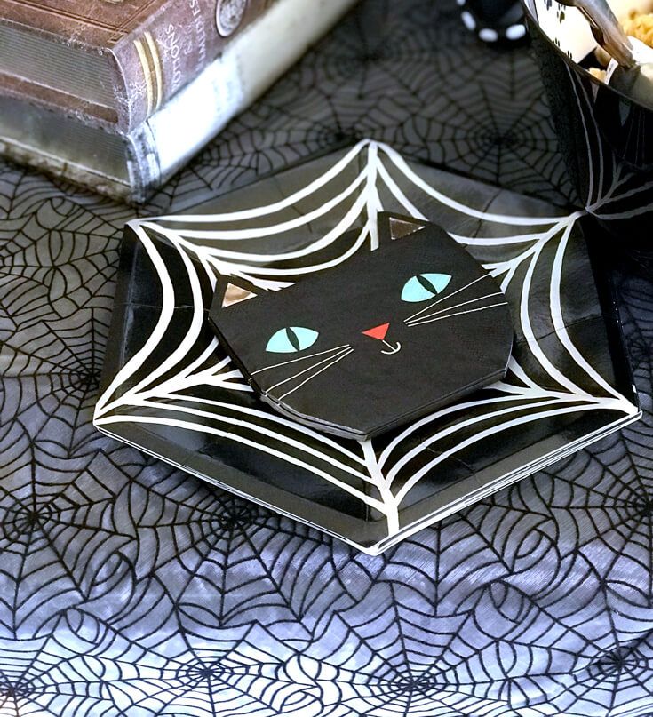 """Mixing black cat napkins and spider web plates made for a fun and slightly spooky snack time. """"Black Cat Halloween Party Reveal"""" on Halfpint Design - Halloween party ideas, kitty cat party, kids party, cat party treats"""