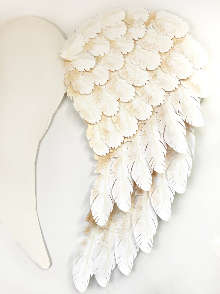Here's one finished wing. I created angel wings with my Cricut Explore Air for a Peace on Earth holiday display. Check out how I did it and grab the feather svg files to make some magic for your home! Holiday Angel Wing Tutorial at Halfpint Design. Great for Christmas, Easter, Halloween, Baby Showers, and general home decor.