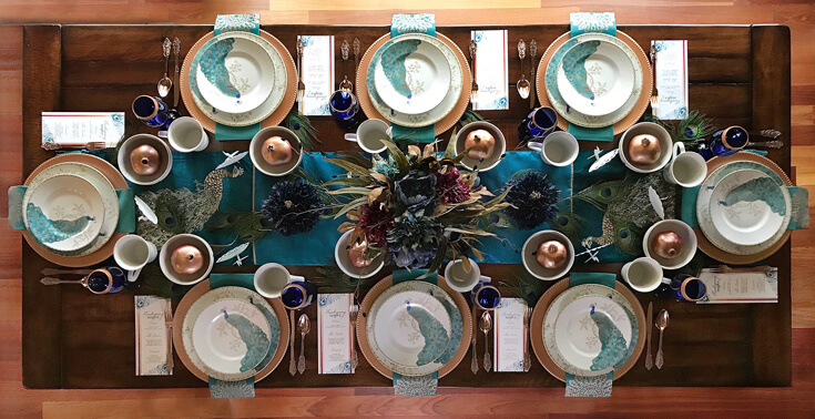 Peacock China, copper chargers, custom place cards with Far East flair makes for exotic Thanksgiving, Christmas, or dinner party table decor. See more Global Chic Holiday Tablescape ideas at Halfpint Design. Thanksgiving Tablescape, Place setting, Christmas Table, Holiday decor.
