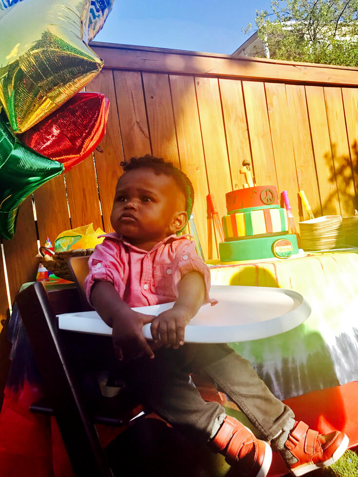 Birthday boy ready to get down and dance at his ONE LOVE first birthday party.