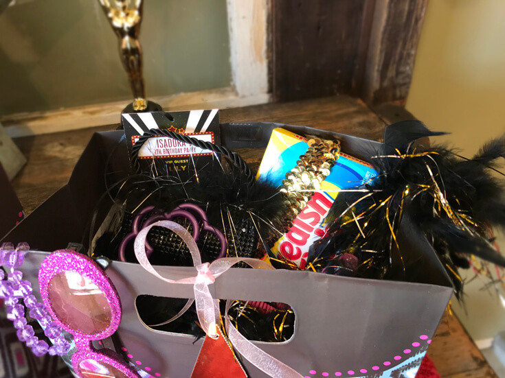 Movie Star party favor. Mini purse, bracelets. feather boa, sequin headband, movie candy, and VIP pass. Halfpint Design