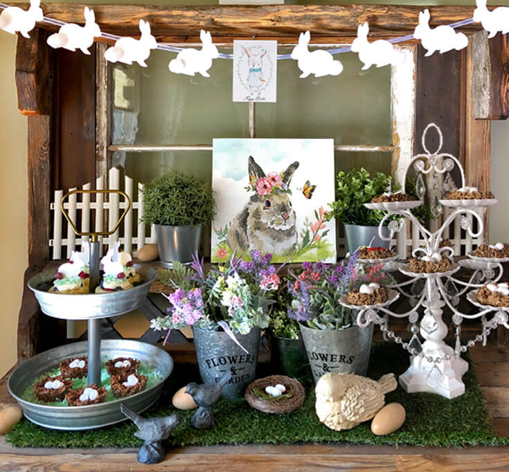 Rustic hutch decorated with easter and spring decor. Bunny banner and easter treats.