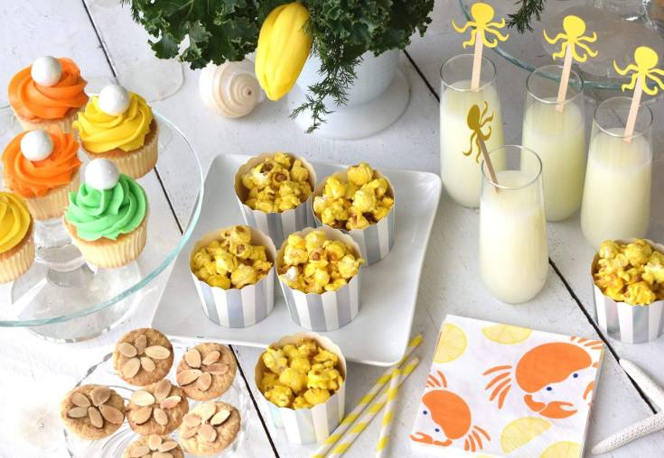 Party food table set for an under the sea party with simple but fun treats. For a children's party on a budget