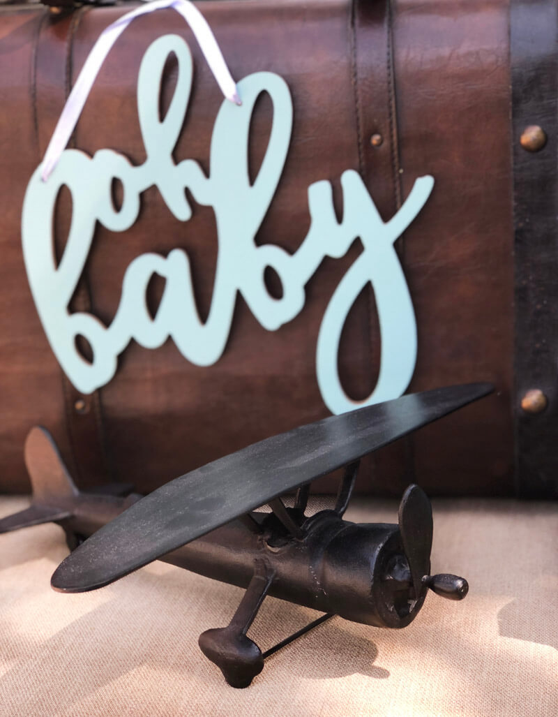 Oh baby sign on vintage suitcase with metal airplane for Up up and Away baby shower