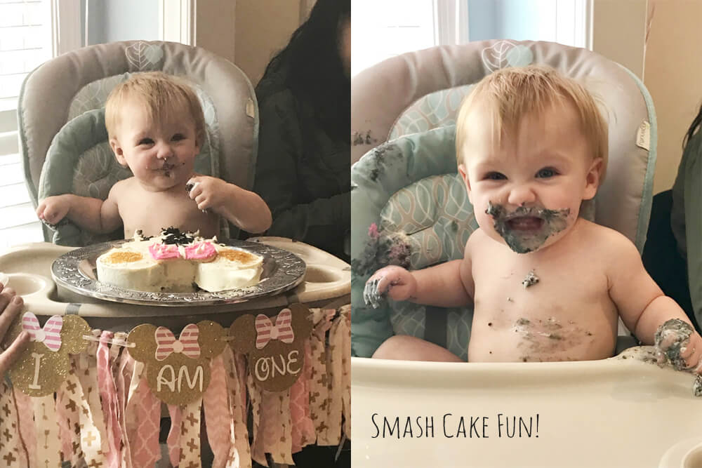 Baby with cake all over her face for Minnie Mouse first birthday party