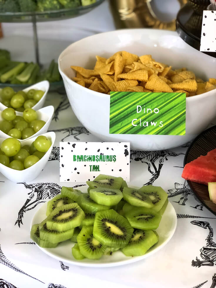 Kiwi and Bugles make Brachiosaurus tails and dino claws using food labels at a dinosaur birthday party