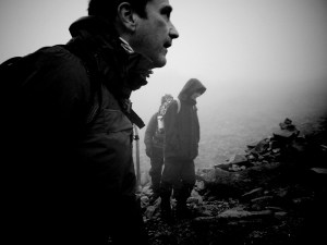 photo of hikers talking near Scafell Pike trig point