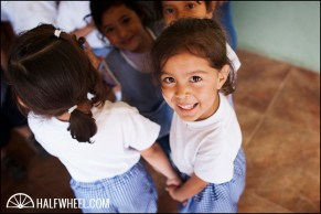 A girl waits to be fed at mealtime at the school.