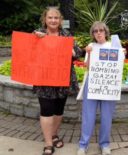 Sharon and Linda with their signs.