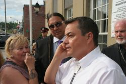 AFN Chief Shawn Atleo speaks to Elsipogtog Chief Aaren Sock on the phone, and promises a July 1st meeting [Photo: Miles Howe]