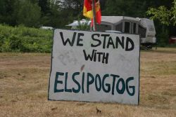 Sign at the sacred fire encampment. [Photo: M. Howe]