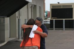 Levi and his soon-to-be wife share a hug upon his release. [Photo: Miles Howe]