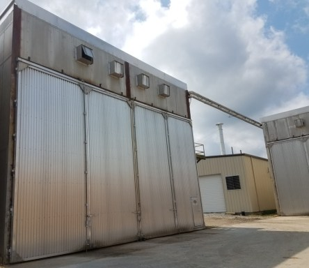 exterior view of building and large metal doors of kiln