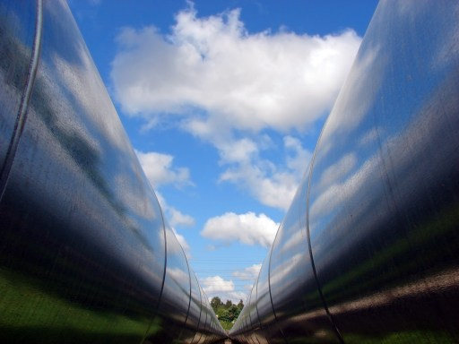 photo taken between two large metal gas pipes