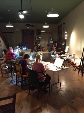 Artist teaching oil painting class.
