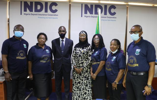 Pix 2: NDIC MD/CEO, Bello Hassan (3rd left) in a group photograph with ICAN Council Member, Sofura Seghosime (4th left), Abuja District Chairman, Bosede Ikanoba (2nd left) and other members during a courtesy visit to the MD/CE in Abuja.
