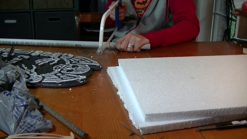 Upgrade Your Cheap Dollar Store Halloween Tombstones Staked with Cut Conduit