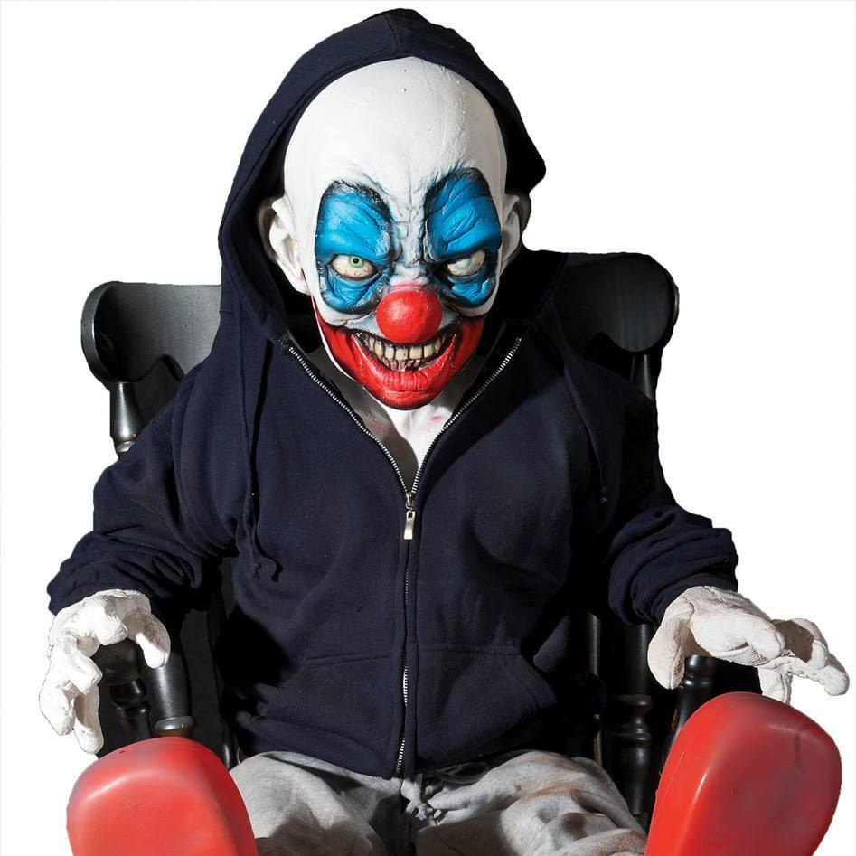 haunted props small clown in chair