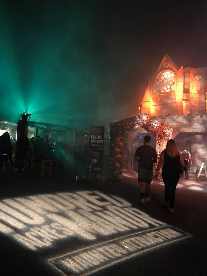 Hundred Acres Manor Haunted House Town Square At Night