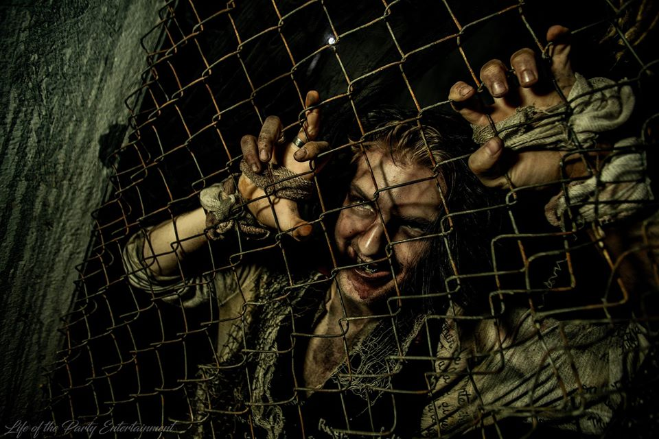 The Haunted Hotel KY Caged Zombie