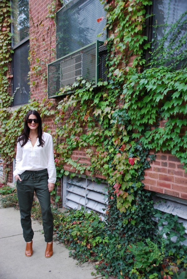 posing in front of ivy wall