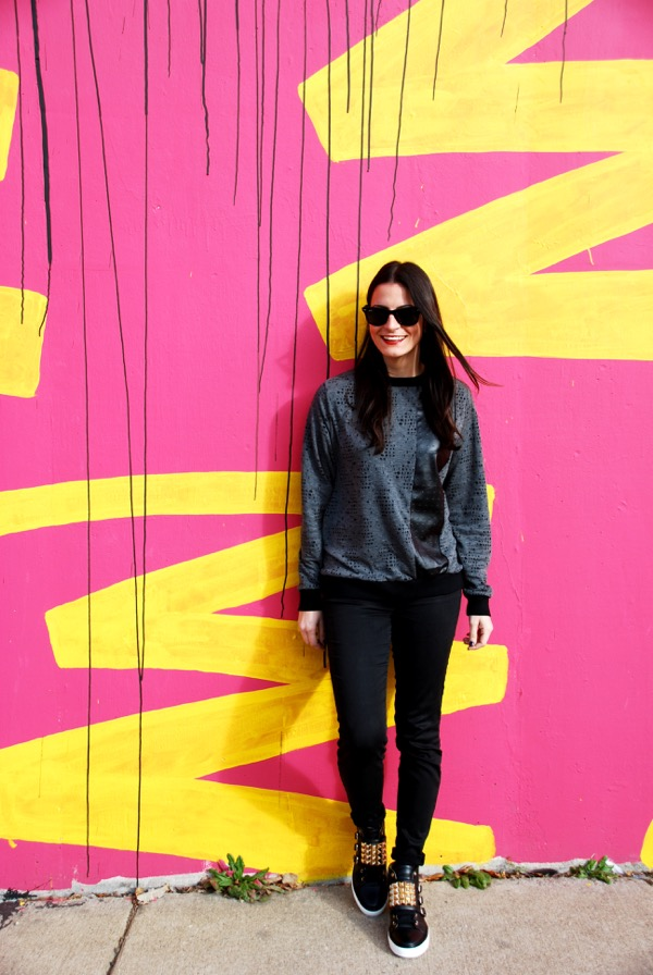 leaning against pink and yellow wall
